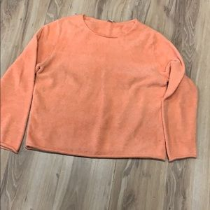 Peach waist length sweater